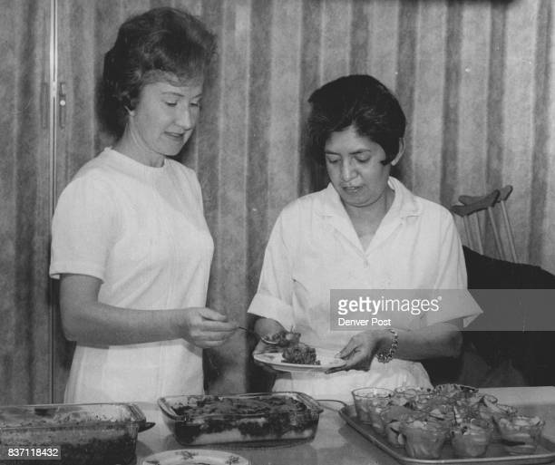 Mrs June Hoton Left and Mrs Melinda Sanders Prepare Meal Mrs Horton and her aide Mrs Sanders teach 'Food for Thrifty Families' course Ways to Stretch...
