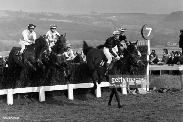 Mrs K Harrer's Castleruddery with Mr Ted Walsh in the saddle leads Matchboard ridden by Bill SahandKydd over the last fence of the 29th Year of the...