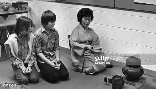 Mrs Katherine Kawakami of TriState Buddhist Church instructs Janine Lebel and Tom Carrasco in traditional Japanese tea ceremony during international...