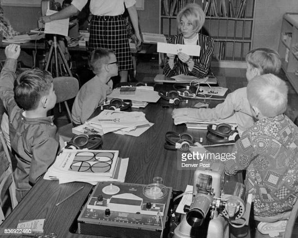 Mrs Kathy Horvath special teacher holds up skill sheet which flashes words at the students At left are Paul Bellvill and Glen Spicer and right Bruce...