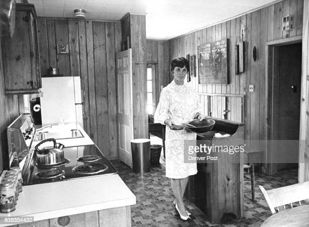 Mrs Kenneth Whiting 4255 Montview Blvd chairman of the Homes tour sponsored by Women of St Thomas Episcopal Church holds some early American kitchen...