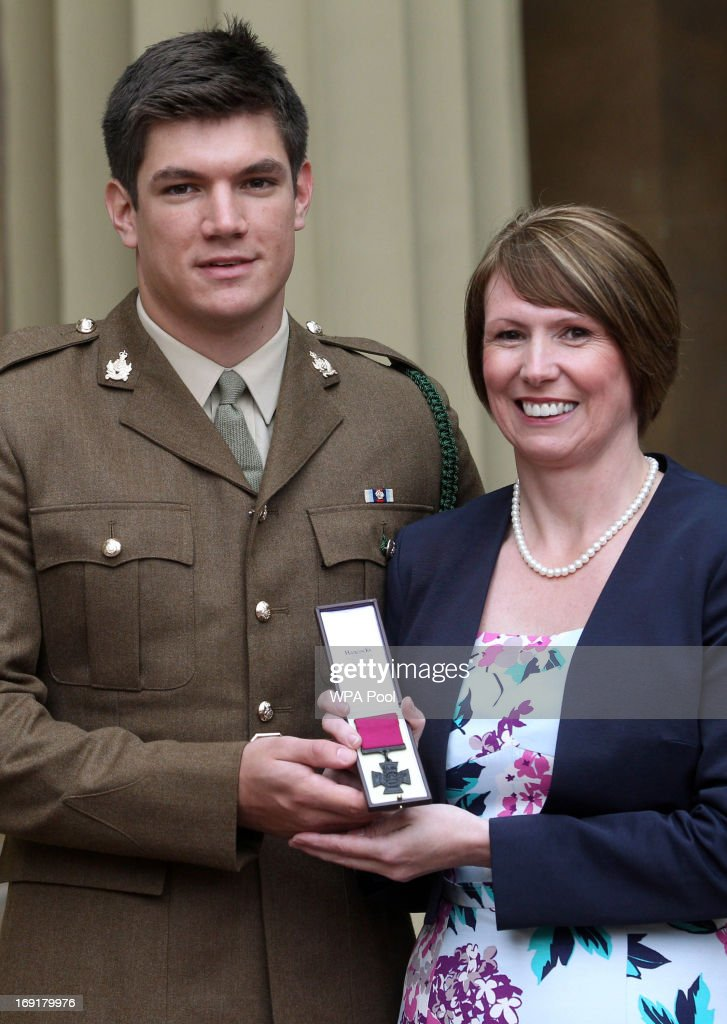 Mrs Kerry Ashworth who received the Victoria Cross on behalf of her late son, Lance Corporal James Ashworth for his service in Afghanistan is seen with her other son Coran at Buckingham Palace on May 21, 2013 in London, England. This is only the 10th time the Victoria Cross has been awarded to a UK soldier since the Second World War.