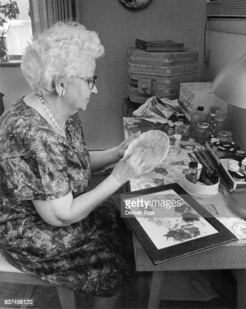 Mrs LaureAnna Duhaime paints a little plate in her apartment at 1327 Steele St Denver Her kiln is in background Credit Denver Post Inc
