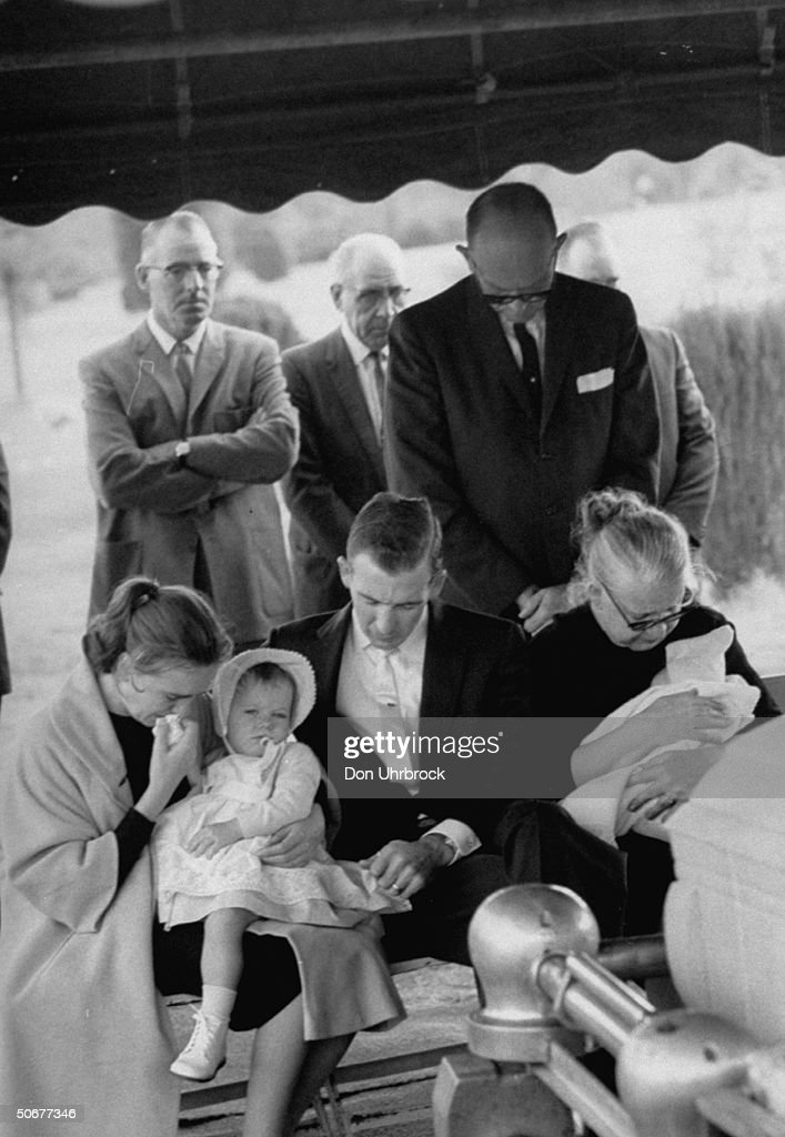 Mrs. Lee H. Oswald (L) and family, Robert L. Oswald (2R), and Mrs. Marguerite Oswald (R), weeping at funeral for Lee H. Oswald.