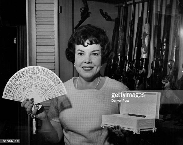Mrs Lloyd C Powers displays some of the souvenirs her husband brought back from his hunting safari in Africa Credit Denver Post