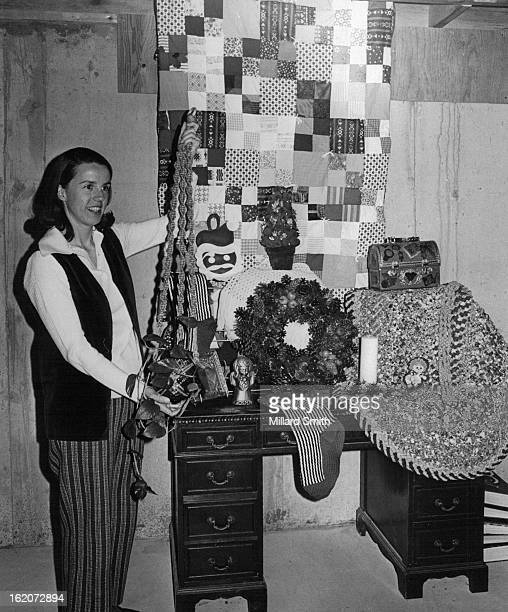 SHOWN Mrs Loren Markley holds macrame plant holder that will be among items at 'BazaarBotique' at Saint Timothy's saint Timothy's bazaar