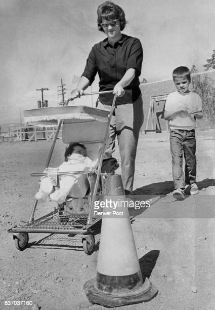 Mrs Lowell Byers 1683 S Patton Court pushes baby carriage through a course Also touring are Nancy Jo and Bradley Byers Credit Denver Post