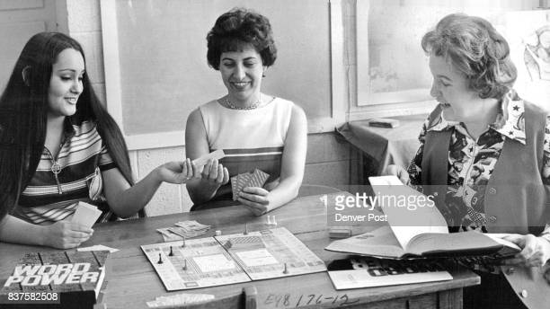 Mrs Marge Heffron above right director of the tutorial adult classes plays a word power game with Mrs Freddi Trippy left a recent GED graduate and...