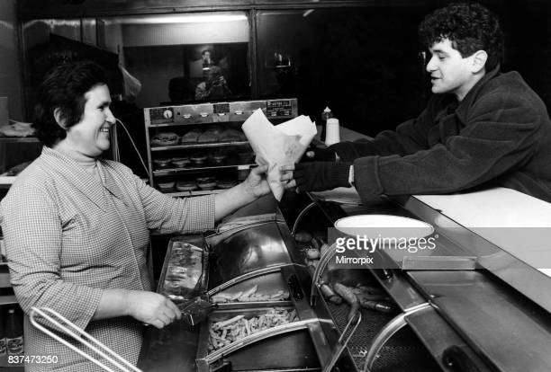 Mrs Maria Stavri serves a customer in a Cardiff fish and chip shop March 1984