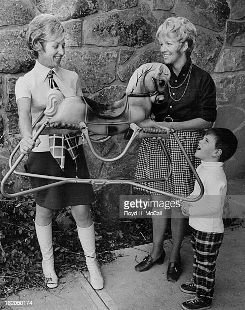 FEB 9 1970 FEB 26 1970 MAR 4 1970 Mrs Mark Hogan and Mike gave Rocking Horse Gift is accepted by Mrs Edward Lipan sale cochairman