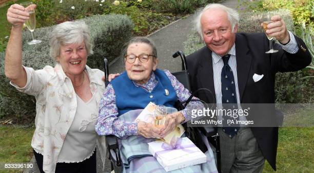 Mrs Mary Brown smiles on her 110th birthday during her party at Eastlake Residential Home in Guildford with her Daughter in Law Zoe Brown 73 and Son...
