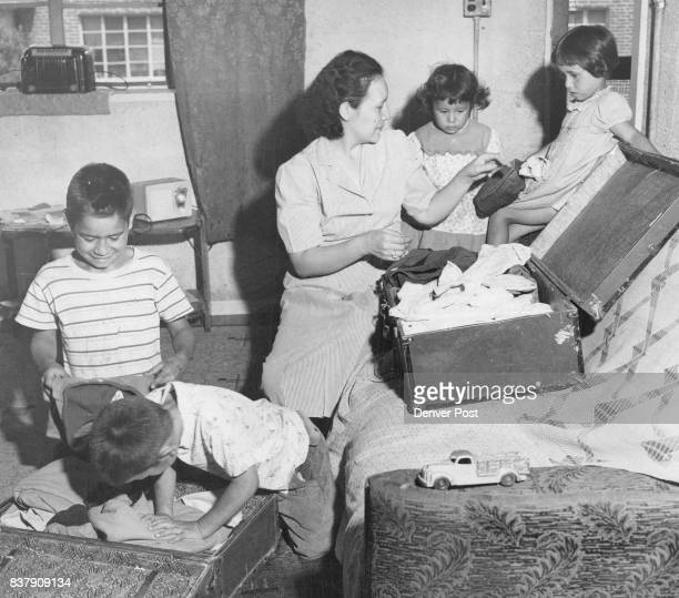 Mrs Mary Fresques gets help from four of her eleven children as she packs up Saturday after receiving an eviction notice to leave her apartment in...