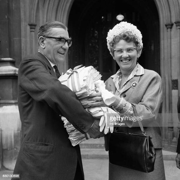 Mrs Mary Whitehouse hands to James Dance Conversative MP for Bromsgrove bundles containing 366355 signatures in support of a petition praying 'that...