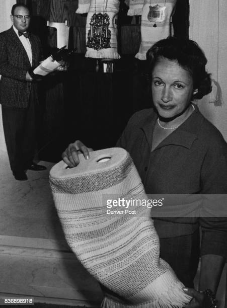 Mrs Max Kaplan 3066 S St Paul St displays mantles of white Persian wool patterned with threads of silver and gold which she wave for the special Holy...