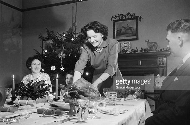 Mrs Merryweather enjoys a Christmas dinner with her family 8th December 1951 Original Publication Picture Post 5609 An Expert's Christmas Dinner pub...