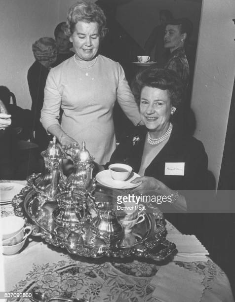 Mrs Montgomery Dorsey seated pours tea for Mrs Ted Johnson at recent membership party honoring past presidents of the auxiliary Credit Denver Post