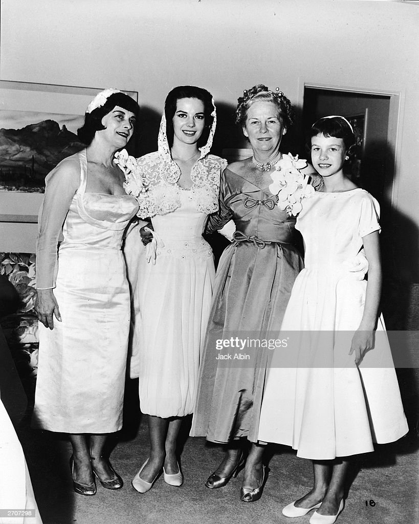 Mrs. Nicholas Gurdin, mother of Natalie Wood, actor Natalie Wood (1938 - 1981), Mrs. Wagner, Robert Wagner's mother, and Lana Wood, sister of Natalie Wood pose together on the day of Natalie Wood's wedding to Robert Wagner, Scottsdale, Arizona, December 28, 1957.