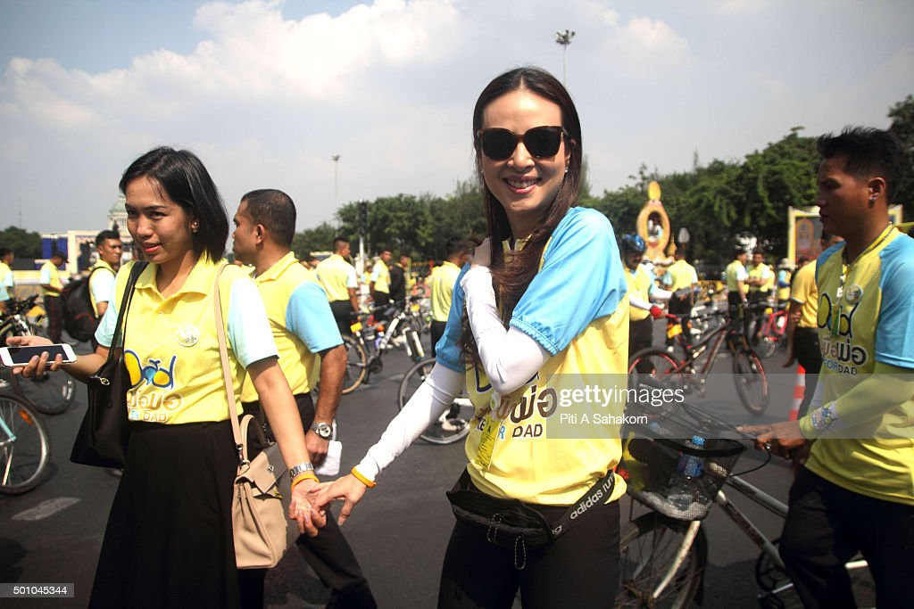 Mrs. Nualphan Lamsam ( Madame Pang ), manager of Thai Nation Women takes part in the 'Bike for Dad' event in Bangkok. The Thai Crown Prince Maha Vajiralongkorn led thousands of cyclists on a 29-km course in Bangkok to celebrate King Bhumibol Adulyadej's 88th birthday.