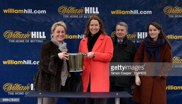Mrs Patrica Pugh collects the trophy after Altior ridden by Nico de Boinville won the William Hill On Your Mobile Novices' Hurdle