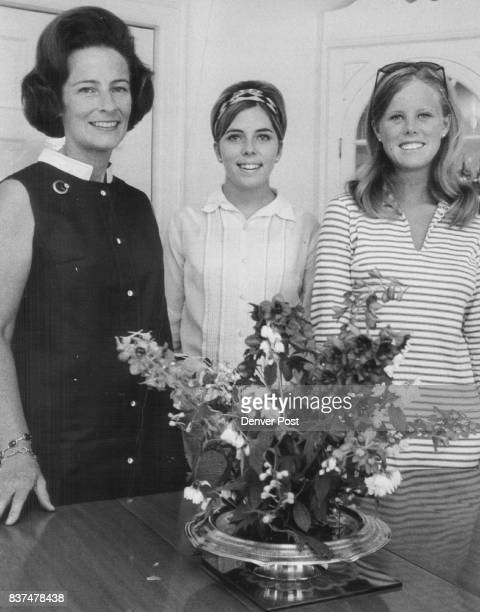 Mrs Paul Douden Jr talks about Yellow rose Ball July 30 with Miss Ann Gast center and Miss Ann Douden Credit The Denver Post