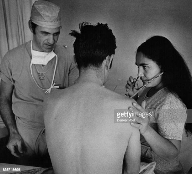 Mrs Ponce listens to suction noises that betrayed Ponce's heart problem as Dr Donald P Elliott adjusts the stethoscope Ponce was told open heart...