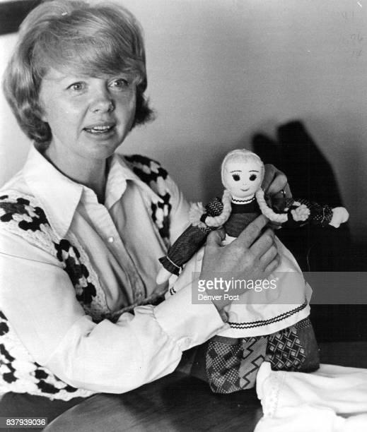 Mrs Quincy Burton holds one of her Appalachian Dolls Littleton Woman Makes Dolls Credit Denver Post