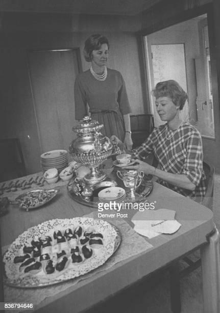 Mrs Raymond Purinton right cochairman of benefit pours tea for Mrs W C Kurtz Jr chairman of show Credit Denver Post