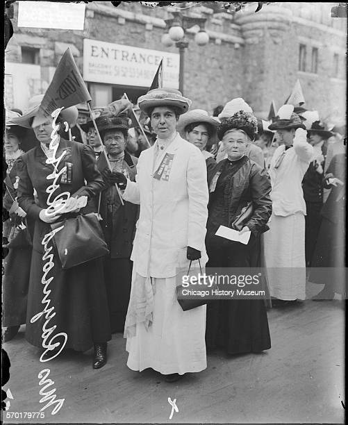 Mrs Raymond Robbins and a group of women suffragists in front of the Coliseum at the time of the Republican National Convention Chicago Illinois 1912...