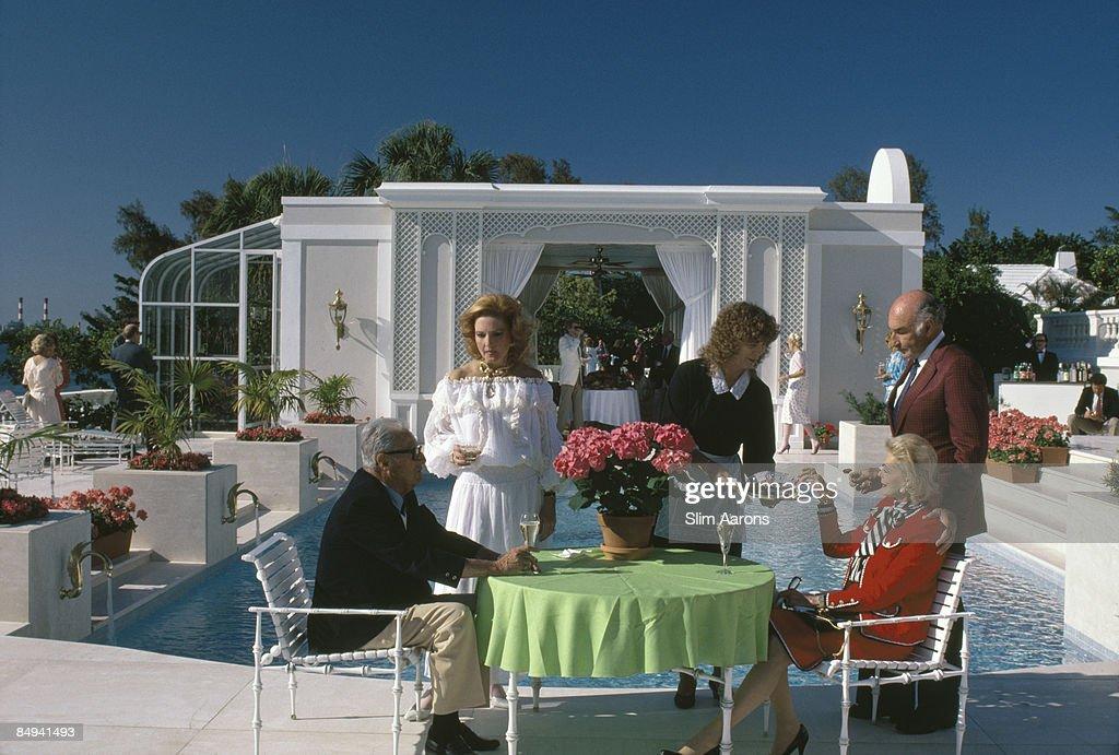 Mrs Robert Gottfried at a poolside in Palm Beach, Florida, 1985.