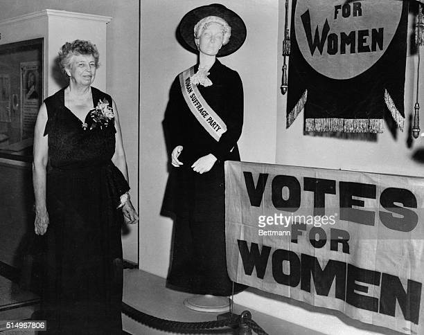 Mrs Roosevelt looks over the woman's suffrage exhibit Eleanor Roosevelt is shown looking at the exhibit depicting the efforts of three generations of...
