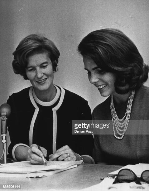 Mrs Ruth Kane Left Is Leader Of Housewives For Lower Food Prices She confers with an aide Mrs Kathy Graybill during meeting of Aurora group Monday...