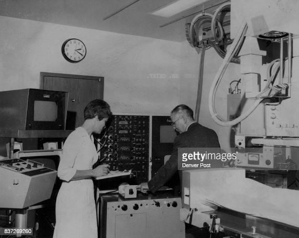 Mrs Ruth Kaufman Left And Ernest Jenks Try New Equipment Mrs Kaufman is cardiovascular laboratory nurse Jenks is St Anthony Hospital...