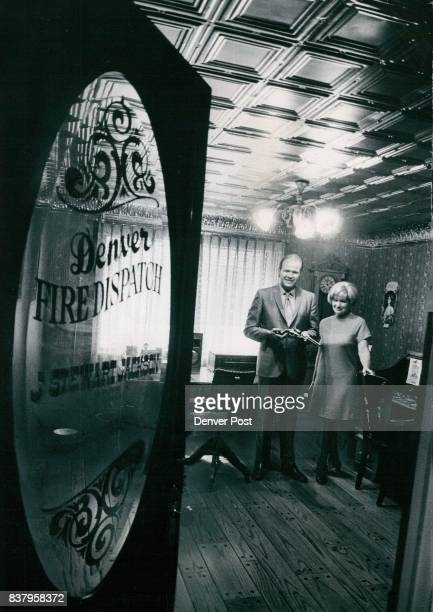 Mrs Sara Jackson president of Denver Burglar and Fire Alarm Co and her son Stewart vice president are in the firm's museum The glassed door carries...