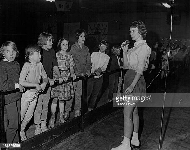 JAN 12 1967 JAN 21 1967 JAN 25 1967 Mrs Timothy 'Foxy' Hawpe skating instructor lines all the Girl Scouts up at the railing while she explains the...