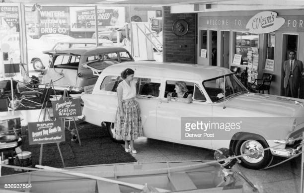 Mrs Use Alcon and Mrs Burnis Zink look over vehicles displayed in O'Meara Ford Center's big show of Ford station wagons at 1100 W Colfax Ave O'Meara...