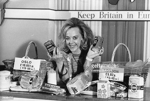 Mrs Vicky Crankshaw demonstrates the prices of goods bought in Oslo and London for the 'Keep Britain in Europe' campaign