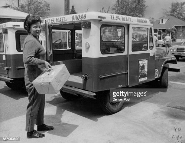 Mrs Virginia Coleman puts package in truck she drives She delivers mail on foot also Credit Denver Post