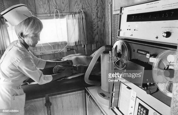 Mrs Virginia Spurlin registered nurse conducts an electrocardiogram one of the many tests given in mobile unit of Health Screening Centers Inc Credit...