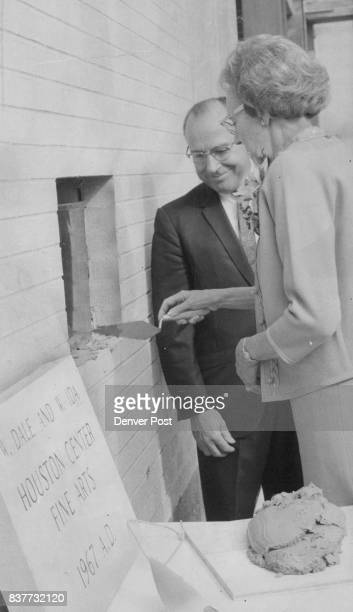 Mrs W Dale Houston James W Pinkard College Cornerstone Laid Mrs W Dale Houston 801 Glencoe St applies mortar Saturday afternoon to seal the...