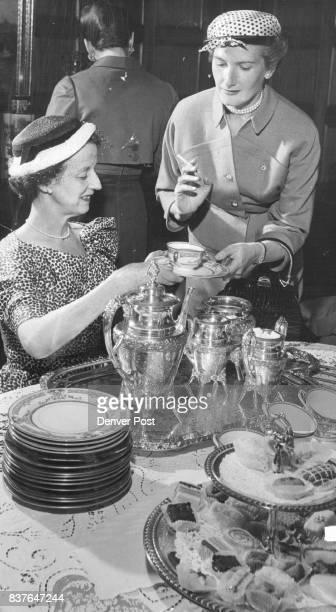 Mrs Will Nicholson serves Mrs Joseph Ross ***** at a recent benefit party for Crippled Children Miss Ruth Clark Mrs Floyd Joy Mrs Vance Kirkland Mrs...