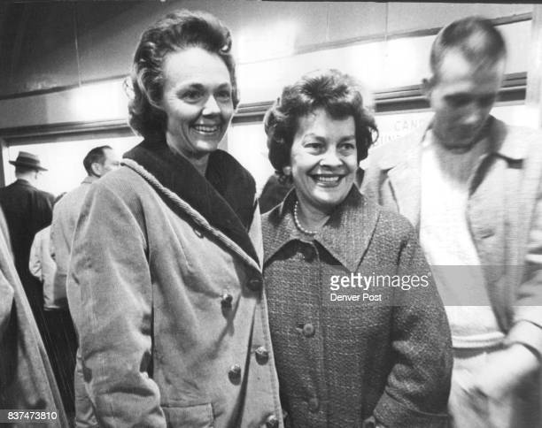 Mrs William E Bower and Mrs Dayton Denious await arrival of their husbands in the DU Arena lobby Credit Denver Post