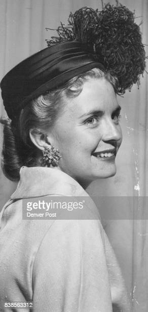 Mrs William Moore models a Christian Dior chapeau to be shown at the Larimer Street Vocational school benefit Sept 26 Credit Denver Post