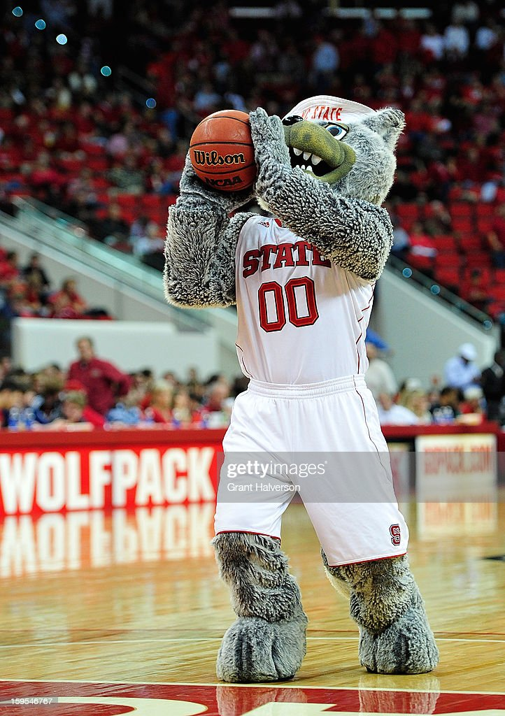 Mr.Wuf, mascot of the North Carolina State Wolfpack, shoots free throws during halftime of a game against the Georgia Tech Yellow Jackets at PNC Arena on January 9, 2013 in Raleigh, North Carolina. North Carolina State won 83-70.