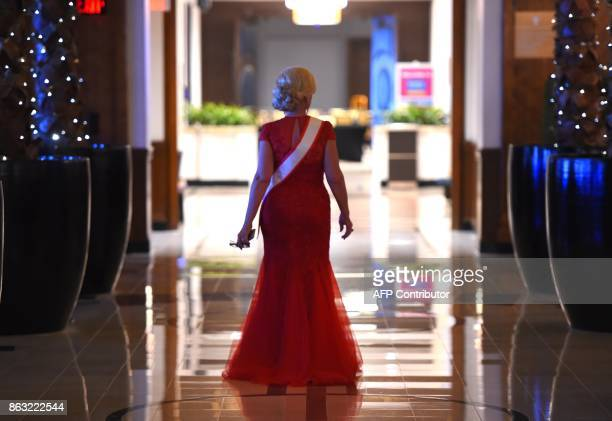 Ms Alabama Rita Young Allen walks in a hallway before the finals of the 38th Annual National Ms Senior America 2017 Pageant held at the Resorts...