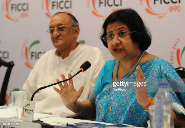 Ms Arundhati Bhattacharya Chairperson State Bank of India addressing and Amit Mitra State Finances Minister and Former Chairman of FICCI at the 14th...