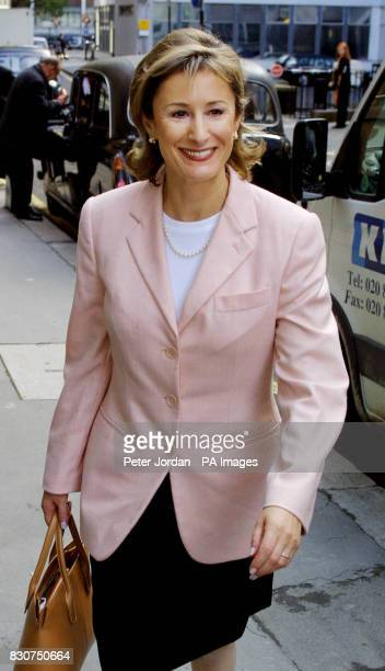 Ms Carol Galley arrives at the High Court Bream Buildings in London where she is fighting for her reputation as a top fund manager 6/12/01 A 130...