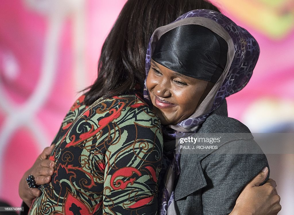Ms. Fartuun Adan of Somalia is hugged by US First Lady Michelle Obama (L) after she was presented with the Secretary of State's International Women of Courage Award inside the Dean Acheson Auditorium of the US Department of State March 8, 2013, in Washington. The Secretary of State's International Women of Courage Award annually recognizes women around the globe who have shown exceptional courage and leadership in advocating for women's rights and empowerment, often at great personal risk. Since the inception of this award in 2007, the Department of State has honored 67 women from 45 different countries. AFP Photo/Paul J. Richards