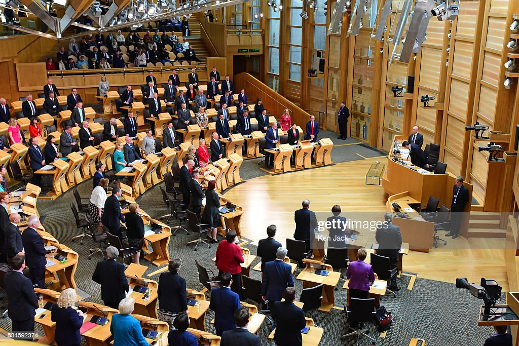 MSPs stand as the Presiding Officer of the Scottish Parliament takes his seat, before a statement by First Minister Nicola Sturgeon on her Government's policy programme for the next five years,