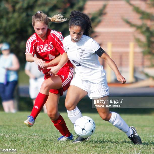 Mt Ararat Reese Turcotte and Brunswick Maeve Arthur battle for possession in first half action at Brunswick girls' soccer