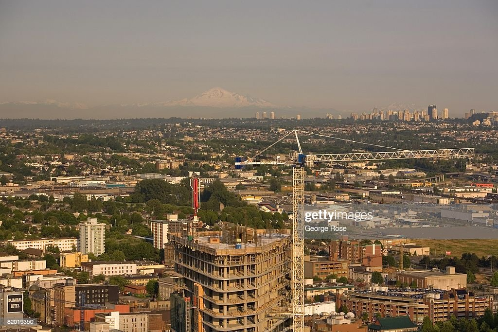 Mt. Baker is seen in the distance while highrises dot the downtown in this 2008 Vancouver, British Columbia, Canada, urban landscape photo. This West Coast Canadian city will host the 2010 Winter Olympics.